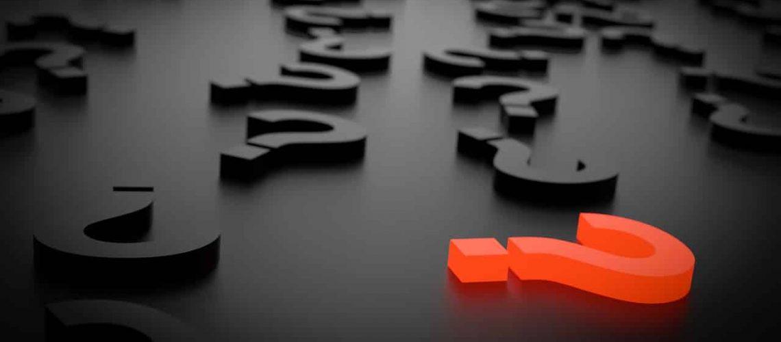 Een rood vraagteken tussen zwarte vraagtekens die illustreren de dringende vraag waarop jij antwoord kan geven.